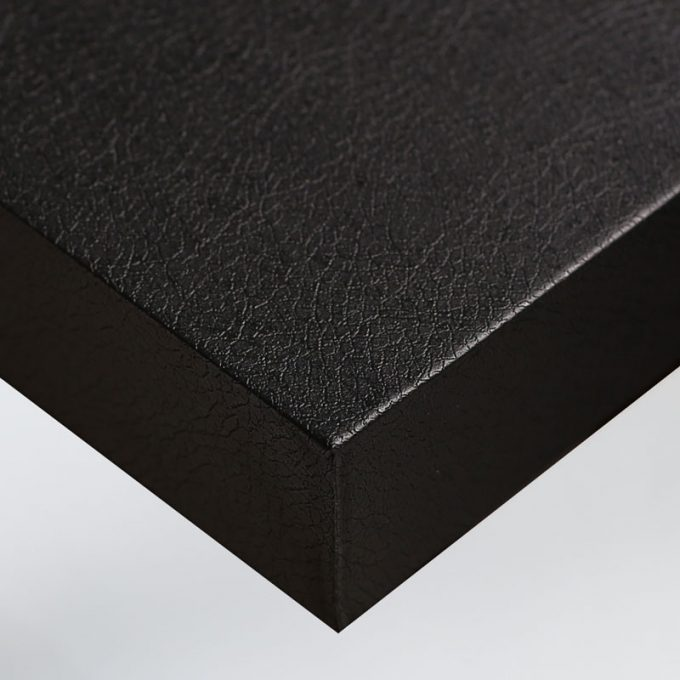 Customized furniture with textured conformable self-adhesive covering Black Leather for an elegant black leather effect