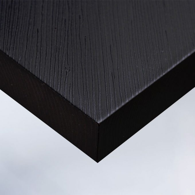Customized furniture with textured conformable self-adhesive covering Black Wood for a black wood effect